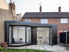 This extension to an east London residence features blackened wood cladding that references Japanese architecture and a dedicated walkway for cats via dezeen Timber Cladding, Exterior Cladding, Residential Architecture, Architecture Design, Japanese Architecture, Design Studio, House Design, Small Bungalow, House Extension Design
