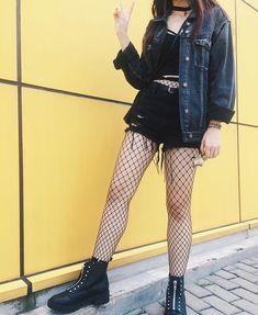 fishnets + black combat boots + black cut off shorts + black crop top + jean jacket
