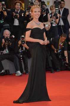 The gorgeous Scarlett Johansson is beyond stunning on the red carpet at the premiere of 'Under The Skin' at the Venice Film Festival in a showstopping black Versace gown
