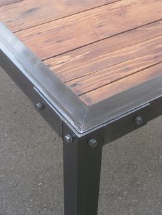 metal table with wood inserts, this would be a cool patio table more info about round patio table read here: http://roundpatiotable.net/