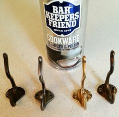 Bar Keepers Friend does a great job reviving antique hooks. Making them shine but leaving a trace of patina and age. Have a look at how they turned out on my wall coat rack at https://www.etsy.com/ca/listing/267826043/wall-hung-coat-hanger-up-cycled-wood?ref=shop_home_active_11