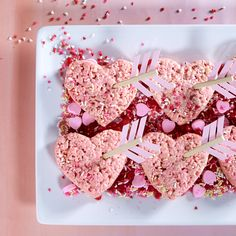 Try these marshmallow cereal treats on a girl date with your best mate. Add red food coloring to a classic marshmallow puffed rice recipe and cut out with a heart-shaped cookie cutter. Then glue small pieces of colored construction pa- per to a wooden skewer and stick it through the center of the treats to make an arrow.
