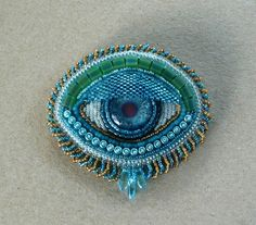 Turquoise 'EYE' hand beaded brooch or pendant by suegoode on Etsy