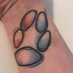 Paw print water colour tattoo