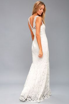 Fall in love with the Elbridge White Lace Maxi Dress! Elegant lace shapes a sleeveless, sweetheart bodice with crochet lace trim, darting, and a fitted waist. An inverted mermaid maxi skirt falls to a stunning floor length. Hidden back zipper/clasp. Casual White Wedding Dress, Wedding Dresses Under 100, White Lace Maxi Dress, Cute White Dress, Stunning Wedding Dresses, Bridal Dresses, White Dresses For Sale, Little White Dresses, Corsage
