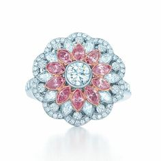 Floral ring with pink and white diamonds in 18k rose gold and platinum.