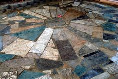 "op: ""free granite pieces from Craig's List turned into a beautiful patio. All the work was done by my teenage son, his girlfriend and my husband and I. The only cost was $12.50 for the decomposed granitewe used for the 'grout'..."""