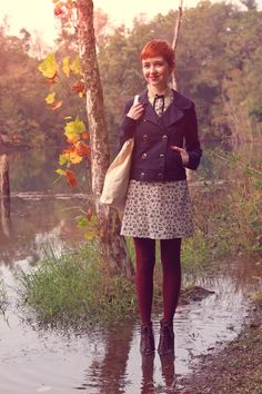 Peacoat-style jacket, thin patterned dress, maroon tights, lace-up boots.
