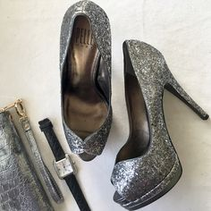 """HP Silver glitter Pelle Moda platforms HOT Silver and gunmetal platform pumps with sexy scalloped peep toe. Tall, slender 5"""" heel, triple covered 1.5"""" platform. Black leather outsole. NEW; never worn. No box, unfortunately, but I will wrap them safely and securely for you. Pelle Moda Shoes Platforms"""