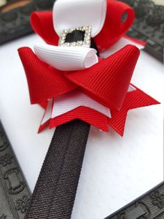 This beautiful mini santa baby boutique headband has been one of my best sellers!!  Red, black and white, 3.5 inch bow attached to a black elastic