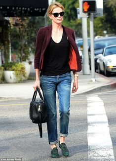 Cool and casual: Charlize Theron was seen leaving Terroni Restaurant in Los Angeles on Fri...