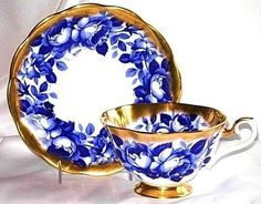 Royal Albert Cobalt Roses Blue Gold Treasure Chest Series Tea Cup and Saucer. I'd love these for my wedding.