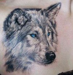 I want a wolf with blue eyes tattoo