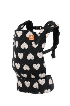 Wild Hearts - Tula Baby Carrier. Wild Hearts - Tula Baby Carrier Ergonomic Baby Carrier - We've taken one of our adorned designs and reinterpreted it for our line of fully printed canvas Tula Baby Carriers. 'Wild Hearts' pays homage to the intensely energetic and passionate way that our littles loves live life! 'Wild Hearts' is a monochromatic design, in black and white, of hearts with an all over distressed look. Explore feverishly, play with tenacity, and love wildly in 'Wild Hearts'!