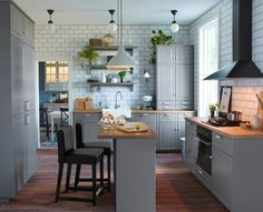 Stylish grey kitchen with BODBYN fronts, porcelain sink and free-standing unit with glass doors. IKEA's new kitchen cabinet system: SEKTION -airy