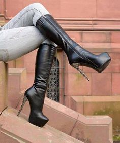 Black leather sleek high heeled,just below knee high boots