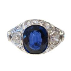 Cushion-Cut Natural Sapphire and Diamond Ring | From a unique collection of vintage cocktail rings at http://www.1stdibs.com/jewelry/rings/cocktail-rings/