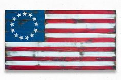 """This Betsy Ross wood flag has a weathered, vintage look. It has been made to appear aged/antiqued. Flag sizes available: 36x20"""" 50x27"""" 60x32"""" Custom sizes available upon request. The Betsy Ross flag w"""