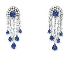 Each designed as a circular and marquise-cut diamond tassel, set at the center and terminals with oval and pear-shaped sapphires, mounted in 18k white gold