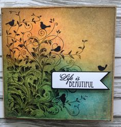 """Cardmaker unknown. Uses Hero Arts """"Leafy Vines"""" stamp, Distress inks, and bird dies from Memory Box. The birds are a clever addition!"""