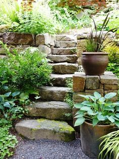 A dry-stacked retaining wall frames a rustic woodland staircase Orion Rockscapes Landscaping with rocks Garden stairs Sloped garden # Sloped Garden, Easy Landscaping, Garden, Landscaping With Rocks, Cottage Garden, Garden Stones, Stone Retaining Wall, Backyard Landscaping, Garden Stairs