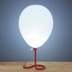Everybody loves balloons! That's why this mood light is the ultimate gift - it looks just like a floating balloon, anchored to a metal stand that looks like a string. It features phasing LEDs, so it g