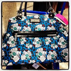 Love this sugar skull Betsy Johnson weekender bag - I have a similar one in black and pink.