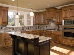 oak cabinets stone backsplash marble topped island - Island Ideas For Kitchen