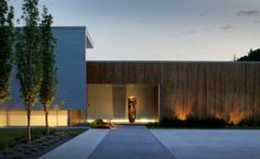 Timber cladding - no eaves. Feature lighting on wood.