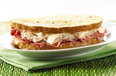 Grilled Reuben Sandwiches recipe: TIP: Use deli pastrami instead of corned beef, divide pastrami into sandwich portion sizes, heat indidvidual pastrami portions in pan, top each portion with slice of swiss cheese and cover to melt cheese, remove with spatuala and place on rye bread, add sauerkraut and dressing, grill on both sides.