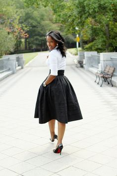 A great statement skirt in an exaggerated shape can work for multiple silhouettes. Wear it high on the waist for height.
