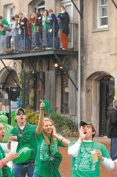 Revelers party on River Street Wednesday during St. Patrick's Day festivites. Richard Burkhart/Savannah Morning News -Savannah, Georgia - Savannah This year's St. Patrick's Day parade is on Saturday, March 15, 2014