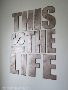 DIY faux metal letters. Spray paint letters in Valspar Stainless steel, then a lite coat of Brown Velvet from a distance, last, dab black on edges w/makeup sponge.