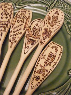 What a cute idea! Wood burn decorations on spoons for kitchen decor