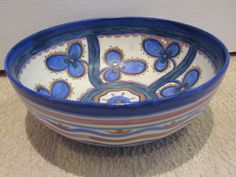 http://www.ebay.co.uk/itm/Carlton-Ware-Handcraft-3-Petalled-Flower-Iris-Fruit-Bowl-1930s-/311745155973?hash=item4895759385:g:aDgAAOSwux5YMhTI