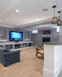 I like the built in storage shelving under the TV. I also like the bar across from the TV, behind the seating.