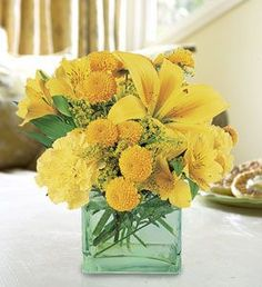 Freshly minted. Our cool green keepsake vase holds the sunniest flowers in the field: alstroemeria for friendship, carnations for beauty and chrysanthemums for fidelity.    Bright yellow alstroemeria, carnations and chrysanthemums arrive in a keepsake gift vase