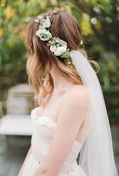 Loose delicate petals cascade into this bride's wedding veil, providing an effortless look for a romantic bride.