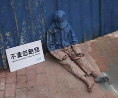 "Transparent homeless children ""Don't Ignore Me"" campaign in China. S)"