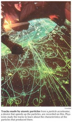Tracks made by atomic particles from a particle accelerator.