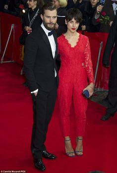 Not for her eyes: Jamie Dornan, left, revealed his wife Amelia Warner, right, 'doesn't want to watch' his latest film Fifty Shades Of Grey. The two are pictured here at the premiere in Berlin, Germany on Wednesday
