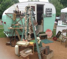 """little camper used on the road as antique store etc. called """"Elkheart""""."""