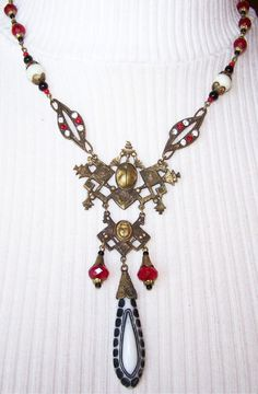Stunning 1920s Art Deco Scarab Red White Black Czech Vintage Necklace. $174.00, via Etsy.