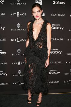 Pin for Later: 17 Stunning Looks From Fashion Week's Chicest Party Hilary Rhoda Feathery, sheer, and supersexy — Hilary stole the show in this unexpected Marchesa look.