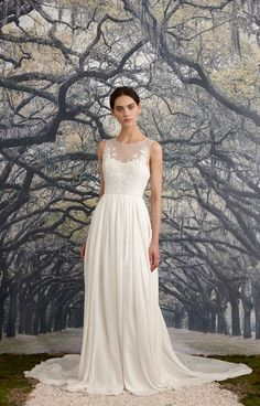 A-line cut gown with an illusion front and back neckline of rose-embroidered…