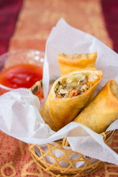 These spring rolls have savory pork, cabbage, glass noodles, carrots and mushrooms wrapped in a thin crackly crisp crust.