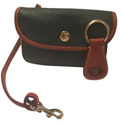 Dooney & Bourke Brand New! All Weather Leather Wallet Pouch Clutch Handbag W/ Matching Leather Key Fob Green & Tan Brown Wristlet. Get the trendiest Clutch of the season! The Dooney & Bourke Brand New! All Weather Leather Wallet Pouch Clutch Handbag W/ Matching Leather Key Fob Green & Tan Brown Wristlet is a top 10 member favorite on Tradesy. Save on yours before they are sold out! SALE $55 FREE SHIP NO TAX!