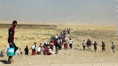 Thousands of Yezidis trapped on Sinjar Mountain as they tried to escape from ISIS forces, are evacuated by Kurdish Peshmerga forces and Peop...