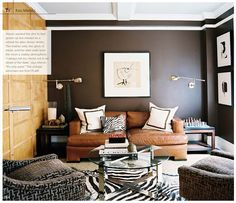 Dark gray sofa background with a simple modern wall art, love the leather sofa.