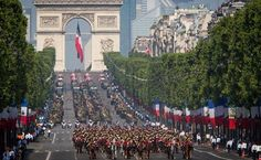 This is a image of the army marching in the street for saint bastille day. Bastille Day is on July 14th and commemorates the storming of the Bastille. They also celebrate Victory of Europe Day and it is on May 8th to celebrate the end of the fighting in World War II.